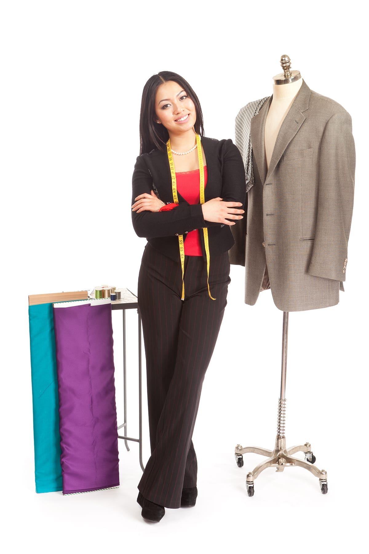 young businesswoman posing with fabrics while she tailors a suit jacket