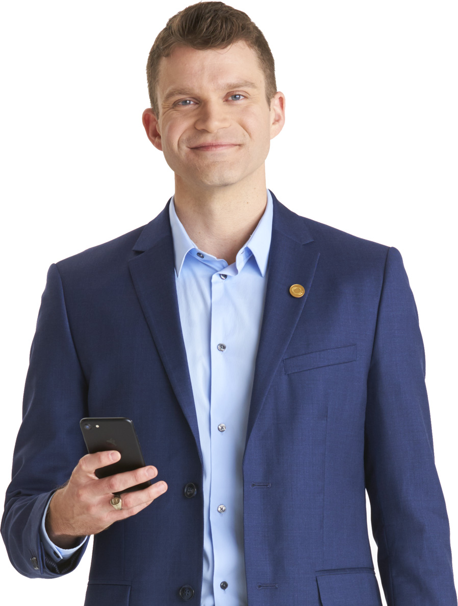 businessman holding mobile device smiling at camera